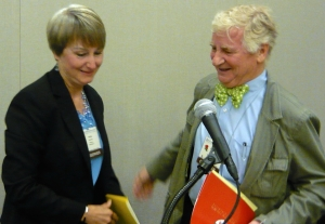 Kathy Bostrom is congratulated by J. Barrie Shepherd at the Presbyterian Writers Guild lunch